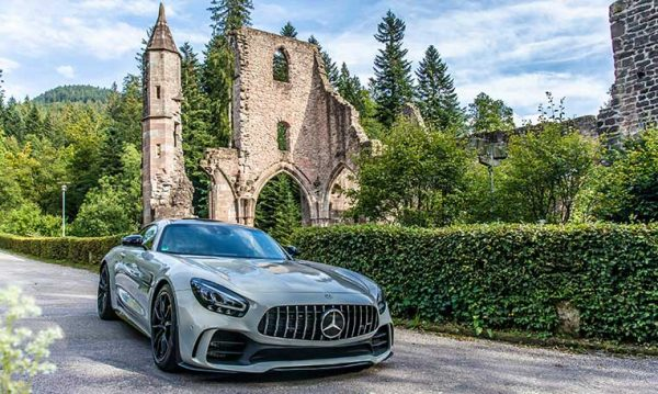 drive in motion Mercedes-AMG in front of Hirsau Monastery